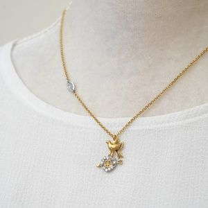 Juicy Couture Peace and Dove Necklace
